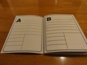 Put the pages in alphabetical order and staple in the middle.