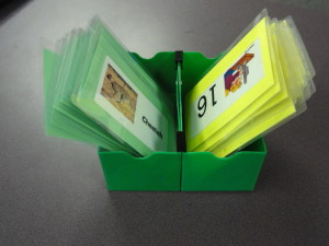 I got these little green boxes with crayola markers and I clamped two of the together and they hold my cards.